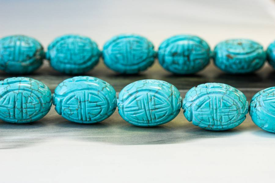 107-0041 Imitation Turquoise 18x25 Carved oval