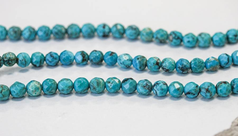 112-2697 Chinese Turquoise 5mm Faceted Round